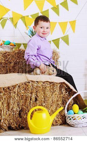 Boy Sitting With Rabbit