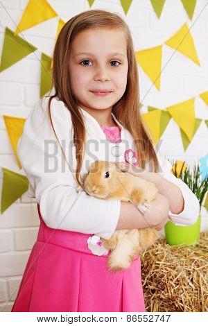 Long-haired Girl Stroking Rabbit