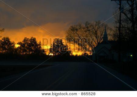 Glowing sunset by corner church