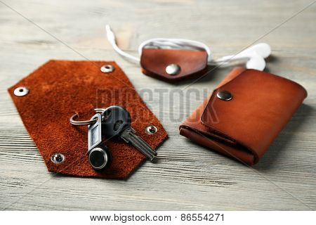 Hand made leather man accessories on wooden background