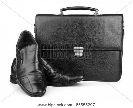 Black leather briefcase with shoes isolated on white