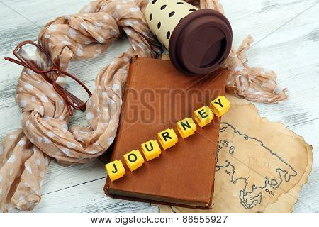 Set of tourist with word Journey on wooden background