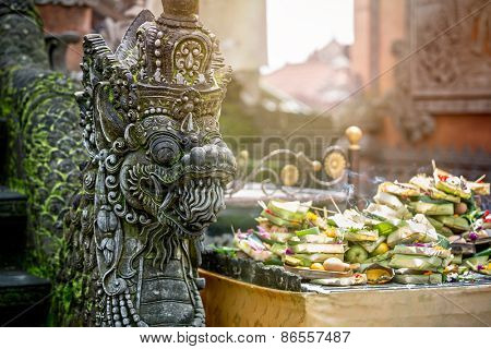 Statues of Hindu God or demons with offerings, Bali, Indonesia