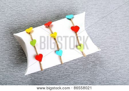 Beautiful gift box on grey background. Valentine Day concept