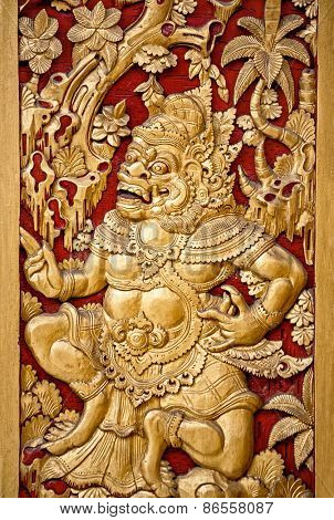 Traditional ornate golden Balinese temple door, Indonesia
