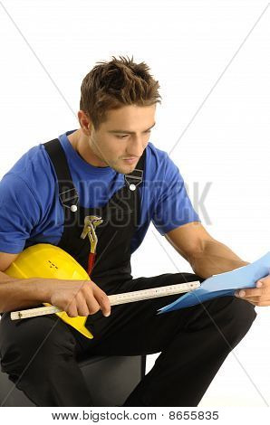 Young Worker Reading Instructions