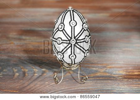 Easter egg on rustic wooden table background