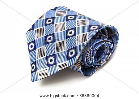 blue tie coiled on a white background