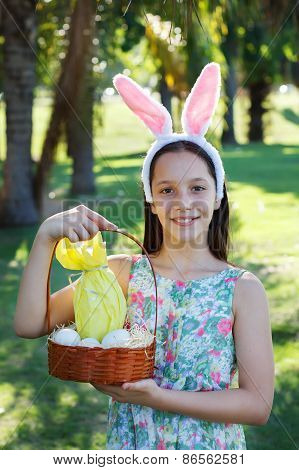 Smiling Cute Teen Girl With Rabbit Ears Holding Chocolate Eggs  For Easter