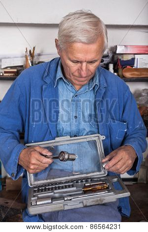 Senior Worker With Tools