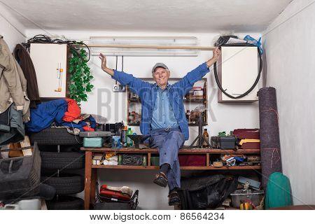 Satisfied Senior Worker In His Workshop