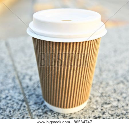 One coffee cup in the city