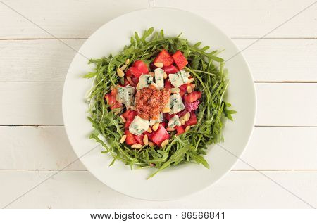 Plate with rucola salad