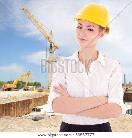 Portrait Of Business Woman Architect In Yellow Builder Helmet