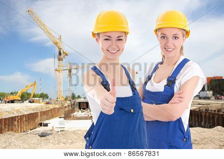 Two Young Women In Blue Builder 's Uniform
