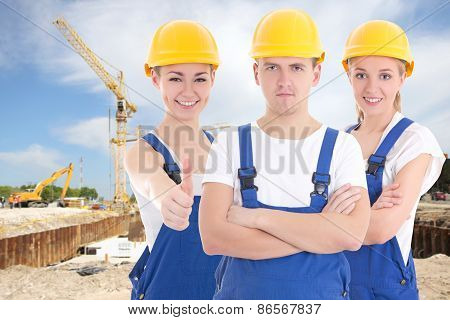 Two Young Women And Man In Blue Builder 's Uniform