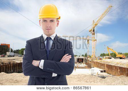 Young Handsome Business Man In Builder's Helmet