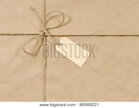 Brown Parcel With Rope And Tag