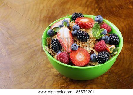 homemade granola muesli with berries (strawberries, raspberries, blueberries) for breakfast