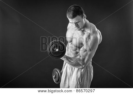 Man makes exercises dumbbells.