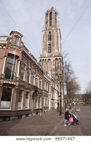 Woman With Trolley Passes The Dom In Utrecht