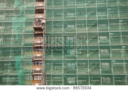 Scaffolding And Green Drapes For Protection