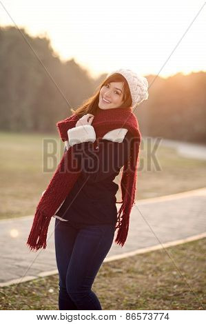 Beautiful Girl In Winter Clothes Smiling With Sunset