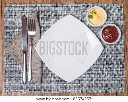Empty Plate With Fork And Knife, Ketchup And Mayonnaise
