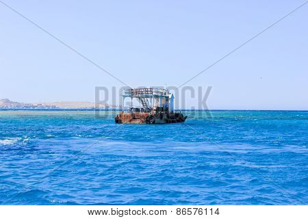 Old Rusty Barge Floating On The Sea