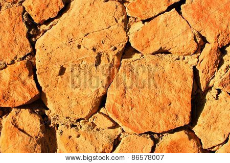 Stone Background At Sun Light. Stone Texture.