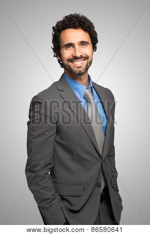 Portrait of handsome confident businessman standing