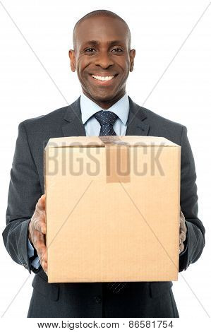 Smiling Businessman Holding Carton Box