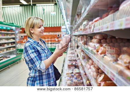 Woman Buys Boiled Sausage In Supermarket