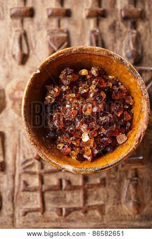 Gum arabic, also known as acacia gum - in bowl