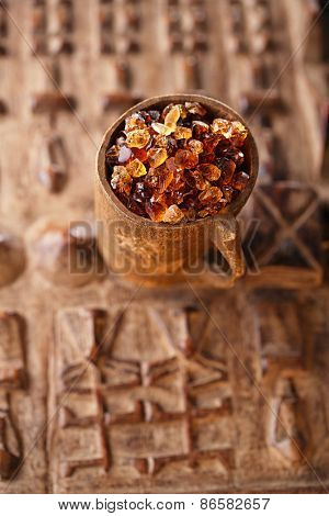 Gum arabic, also known as acacia gum - in wooden mug