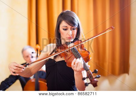 Woman playing her violin