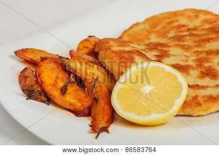 Fried pork chop schitzel with sliced potato