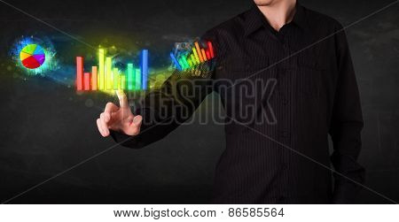 Businessman touching colorful modern graph system concept