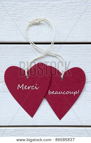 Two Hearts Label With French Merci Beaucoup Means Thank You Vertical