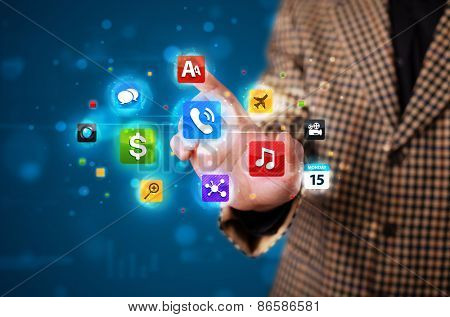 Young businessman pressing various collection of buttons