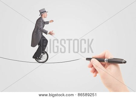 Businessman riding monocycle on a rope drawn by hand concept