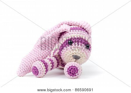 Knitted Rabbit Lays Isolated On White Background
