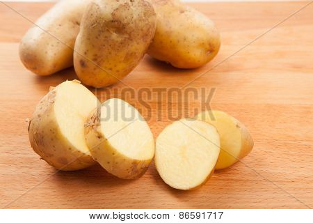 Cut Potatoes On Cutting Board