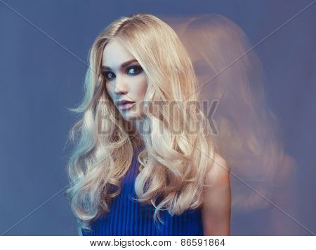 Studio fashion art portrait of young beautiful lady