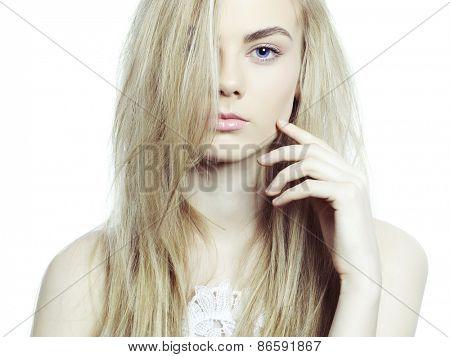 Studio fashion portrait of young beautiful lady on white background