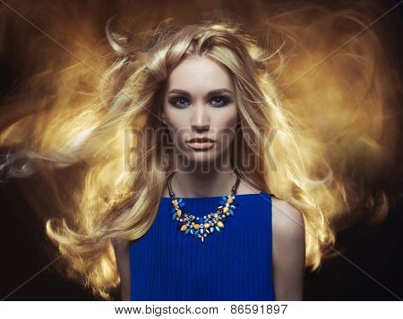 Studio fashion portrait of young beautiful lady on black background