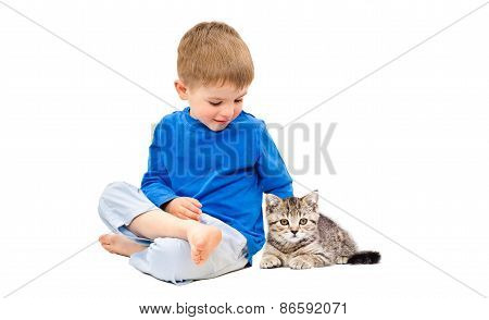 Cute boy sitting with a kitten Scottish Straight