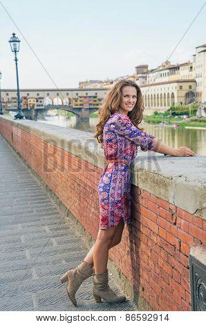 Full Length Portrait Of Happy Young Woman On Embankment Near Pon