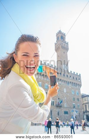 Happy Young Woman Taking Photo Of Palazzo Vecchio In Florence, I