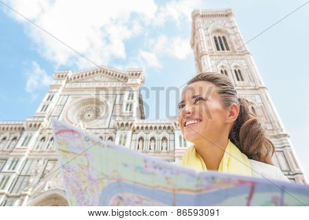 Happy Young Woman With Map In Front Of Duomo In Florence, Italy